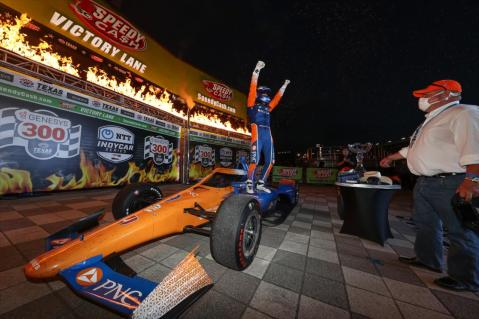 Scott Dixon celebrates winning for the fourth time in his career at Texas